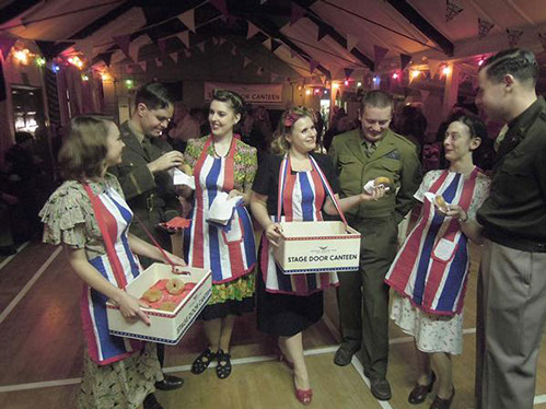 Doughnut Dollies serving GI's at the Stage Door Canteen